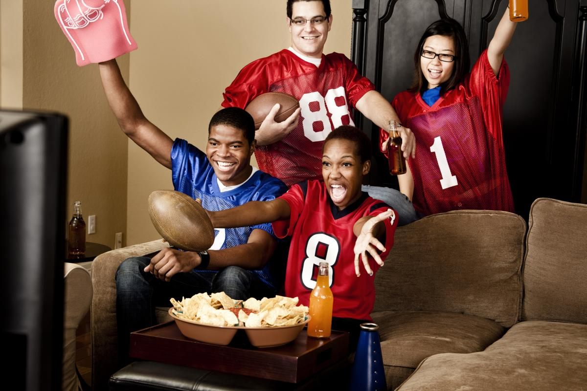 sports fans watching a game on television