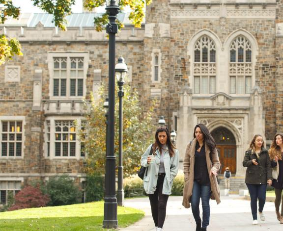 students walking by Linderman Library